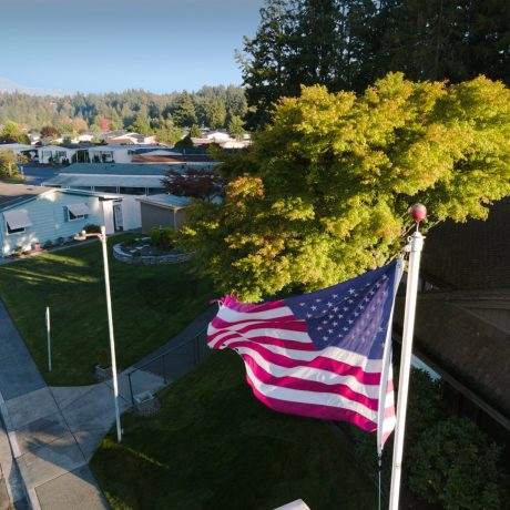 Park Village aerial view of US flag and homes